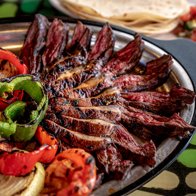 """Hot platter of steak fajitas and sides"" stock image"