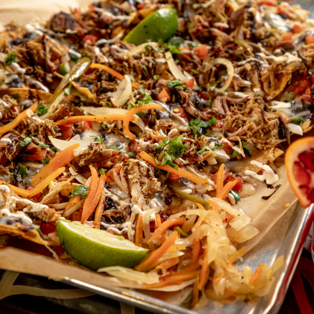 """Platter of pulled pork nachos with margarita"" stock image"