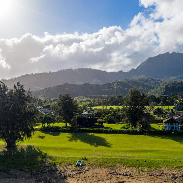 """""""Aerial drone shot of Hanalei town and mountains from Waioli beach park"""" stock image"""