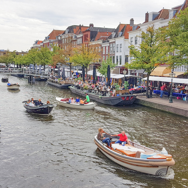 """Busy street and a canal in Leiden"" stock image"