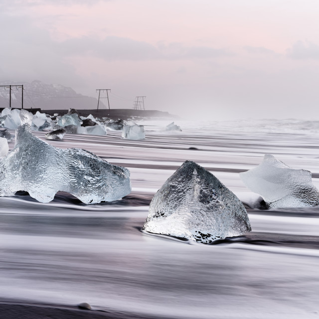 """Morning light on the black ice beach"" stock image"