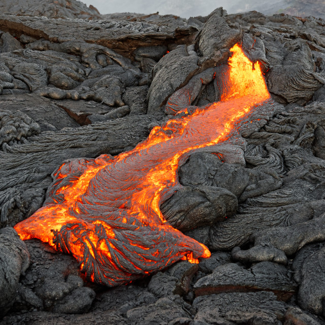 """Hot lava flows from a fissure"" stock image"