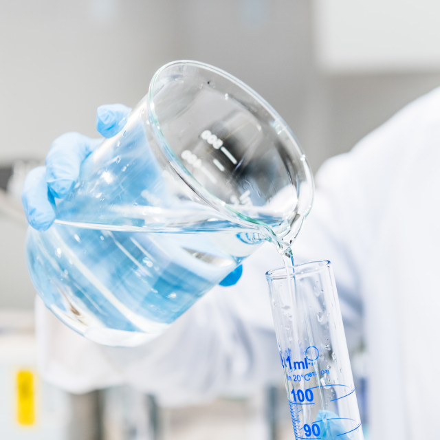 """Pharmacy laboratory hands holding glass"" stock image"