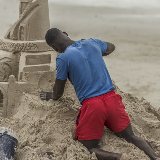 """""""Artist scuplting from sand. On the beach."""" stock image"""