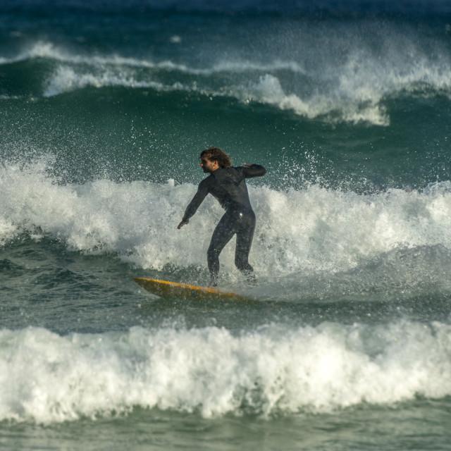 """""""Surfing. Uneven waves, crosswind."""" stock image"""