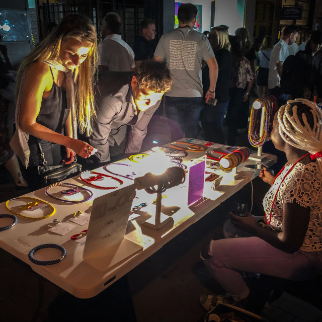 """""""Tourists shopping at an African night market"""" stock image"""