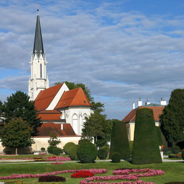 """beautiful garden and church in Vienna Austria"" stock image"