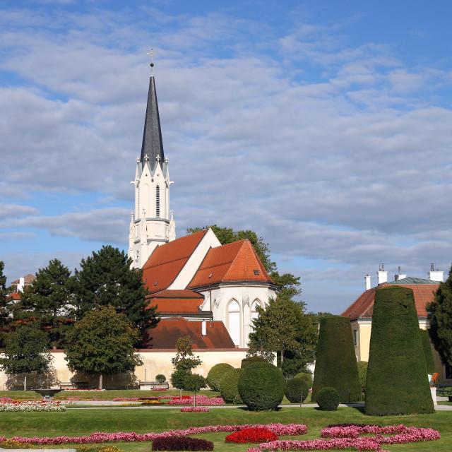 """beautiful garden and white church in Vienna Austria"" stock image"