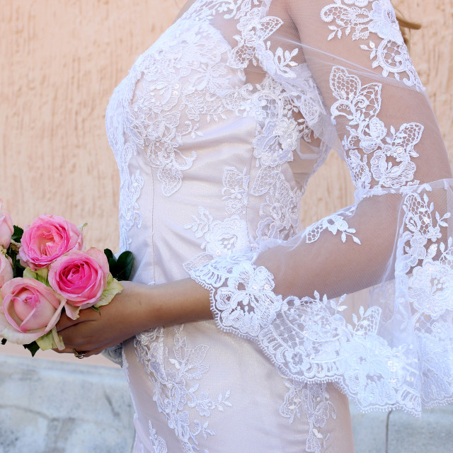 """""""wedding dress and bouquet of roses"""" stock image"""