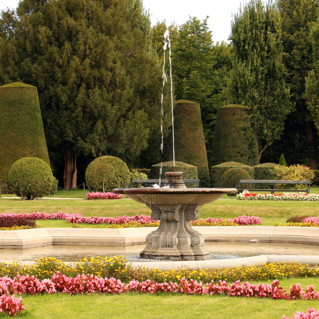 """""""Beautiful garden with fountain and flowers in Vienna Austria"""" stock image"""