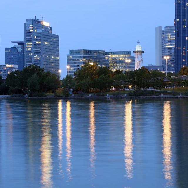 """Vienna skyline on the Danube river at night Austria"" stock image"