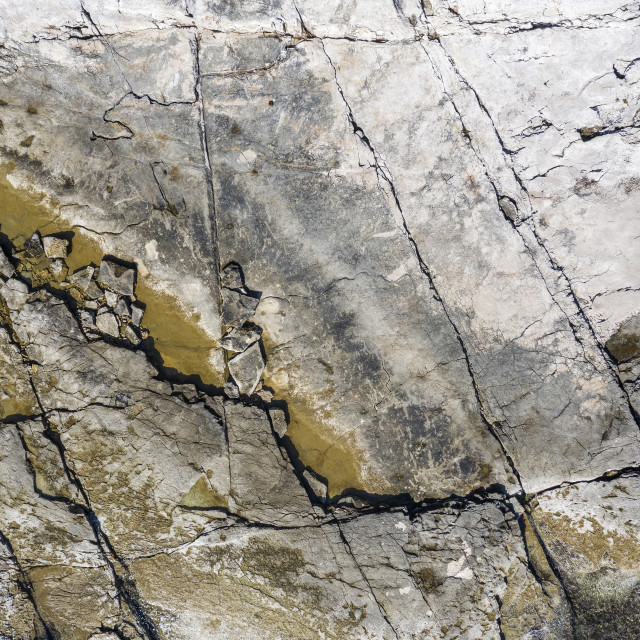"""""""An aerial view of flat cracked rocky cliffs"""" stock image"""