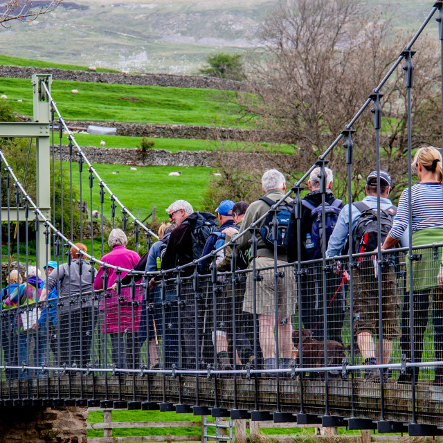 """""""Hikers on Reeth Swing Bridge"""" stock image"""