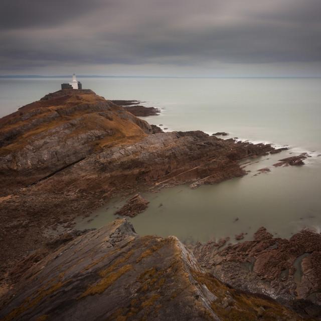 """Calm seas at Mumbles lighthouse"" stock image"
