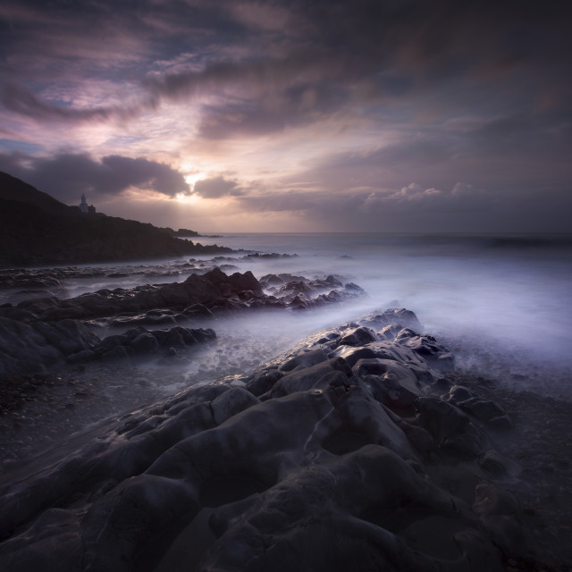 """""""The rocky foreshore of Bracelet Bay"""" stock image"""