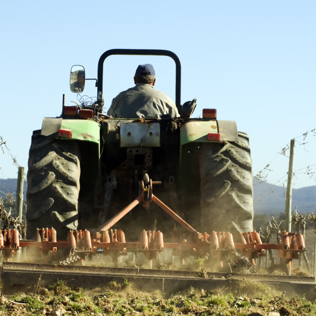 """""""Tractor ploughing field"""" stock image"""
