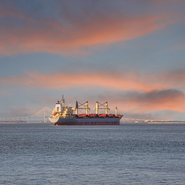 """Dredging Ship in Empty Bay at Dusk"" stock image"