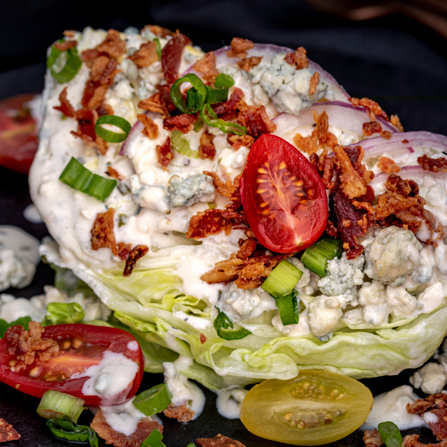 """Lettuce wedge salad with blue cheese dressing"" stock image"