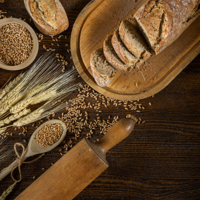 """Bread, traditional bread and wheat on wooden backround."" stock image"