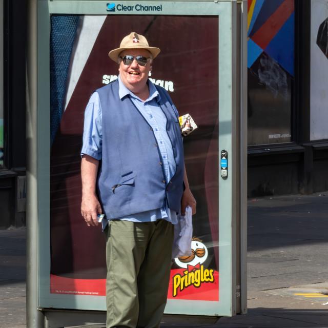 """Deputy Dawg happy guy waiting on the bus"" stock image"