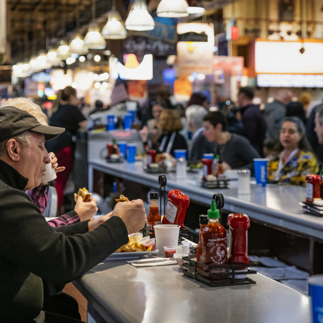 """""""Diners eating lunch at the Reading Terminal Market in Philadelphia"""" stock image"""