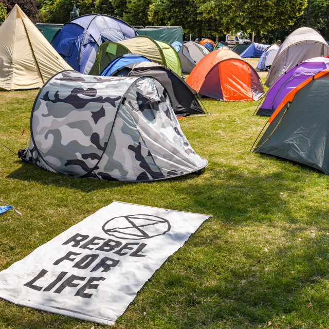 """""""""""Rebel for Life"""" flag on the ground in a makeshift campsite as part of protest by Extinction Rebellion."""" stock image"""