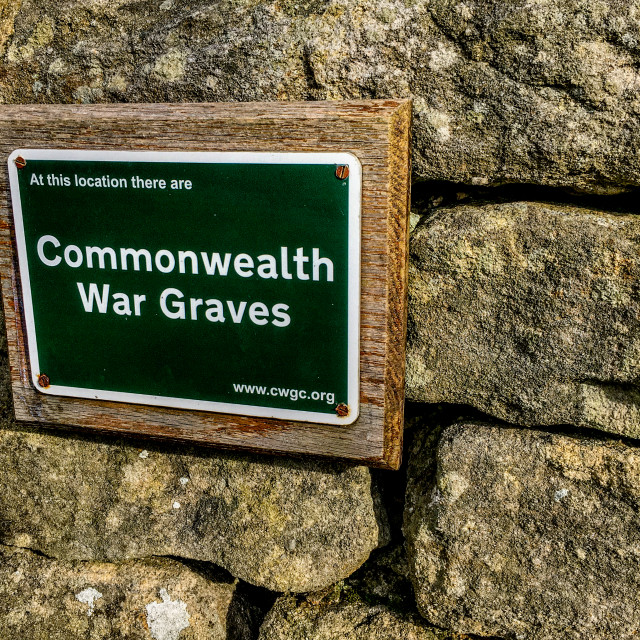"""Commonwealth War Graves Sign at St Peters Churh, Addingham, Yorkshire, UK"" stock image"