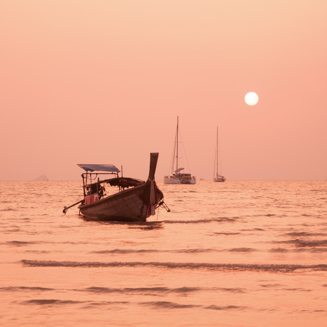 """Longtail boat at sunset, Railay West coastline, Pranang Beach, K"" stock image"