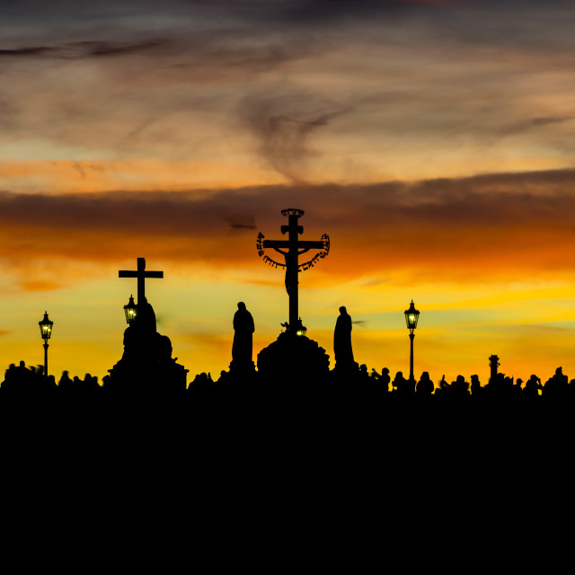 """Silhouettes of Charles Bridge (Karluv Most) statues during yellow sunset"" stock image"