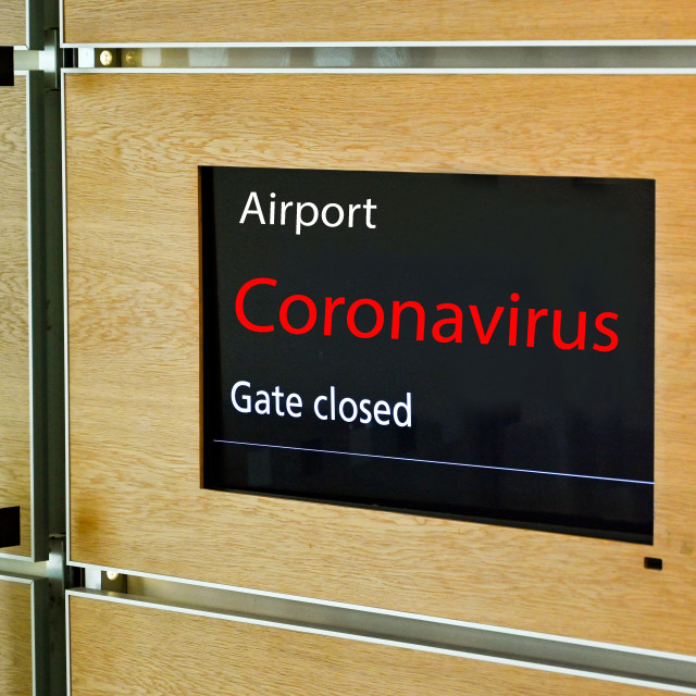 """""""Airport terminal display screen with """"Gate Closed"""" and """"Coronavirus"""" message Heathrow Airport showing the gate has closed for a fight."""" stock image"""