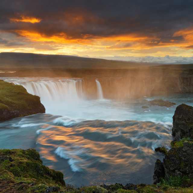 """""""Big waterfall in wild landscape in the evening light"""" stock image"""