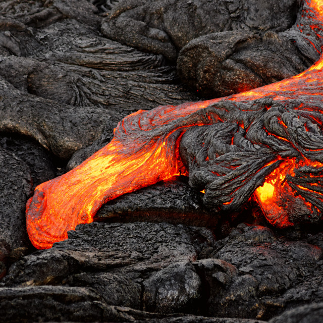 """""""Glowing lava emerges from a column of the earth"""" stock image"""