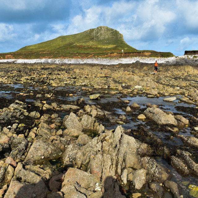 """""""Crossing Worm's Head at Gower"""" stock image"""