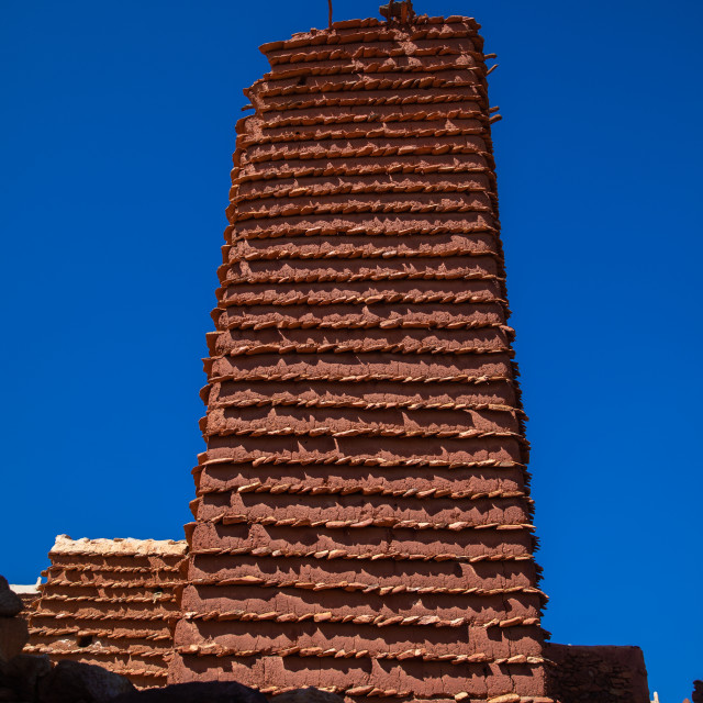 """""""Red stone and mud watchtower with slates in a village, Asir province, Sarat..."""" stock image"""
