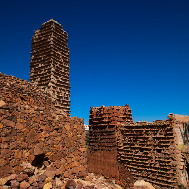 """""""Red stone and mud houses with slates in a village, Asir province, Sarat..."""" stock image"""