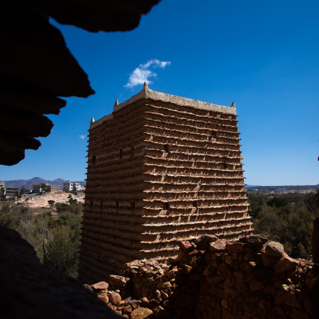 """""""Red stone and mud house with slates in a village, Asir province, Sarat..."""" stock image"""