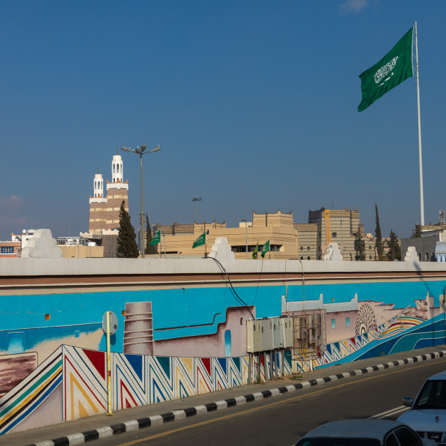 """Saudi arabian flag in front of a fresco, Asir province, Abha, Saudi Arabia"" stock image"