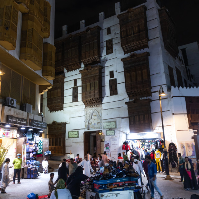 """""""Market in front of a historic house with wooden mashrabiyas in al-Balad..."""" stock image"""