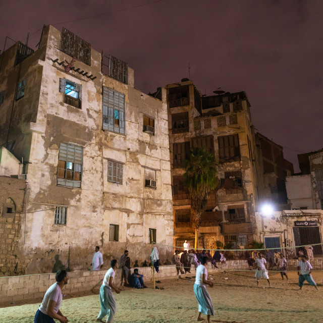 """""""Men playing volley ball in front of old houses with mashrabiyas in al-Balad..."""" stock image"""