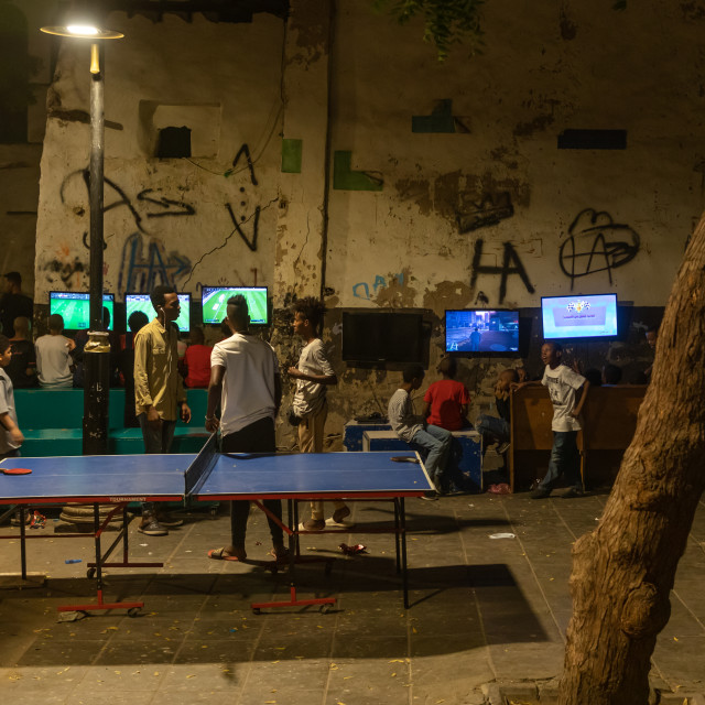 """""""Somali refugees children playing video games in the street in al-Balad..."""" stock image"""