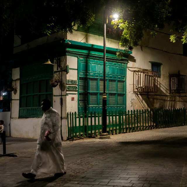 """""""Man passing in front of an old house with mashrabiya in al-Balad quarter,..."""" stock image"""
