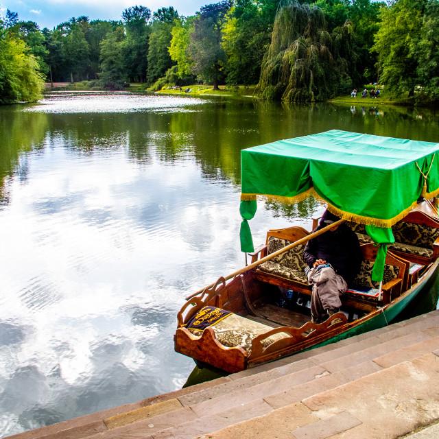"""""""Royal Baths (Łazienki Park), Warsaw, tourist gondola on the lake."""" stock image"""