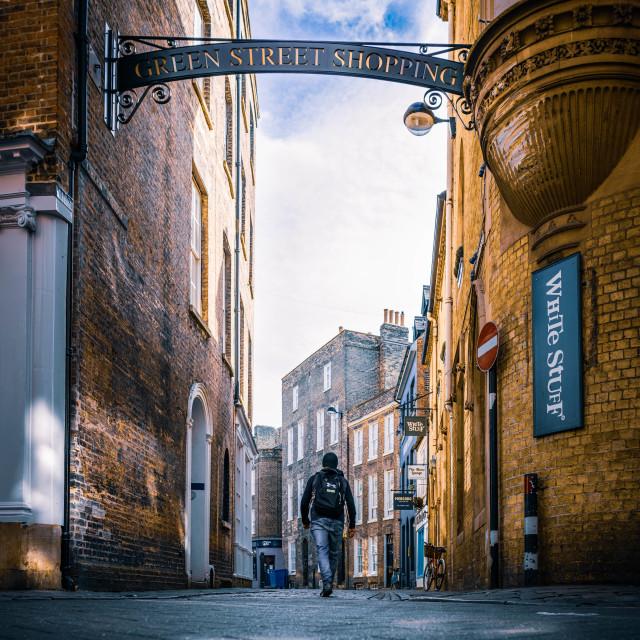 """""""Man walking to the light, Green Street Cambridge UK."""" stock image"""