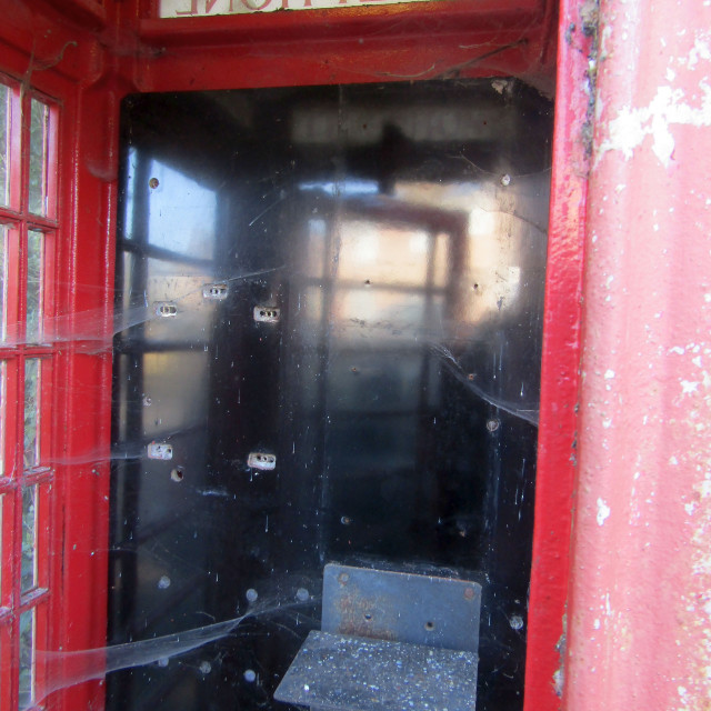 """cobwebs in uk red telephone box"" stock image"