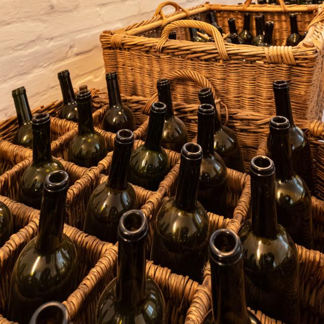"""""""Empty dark glass bottles ready for bottling wine"""" stock image"""