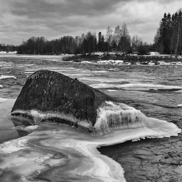 """""""Frozen Rock In The River"""" stock image"""