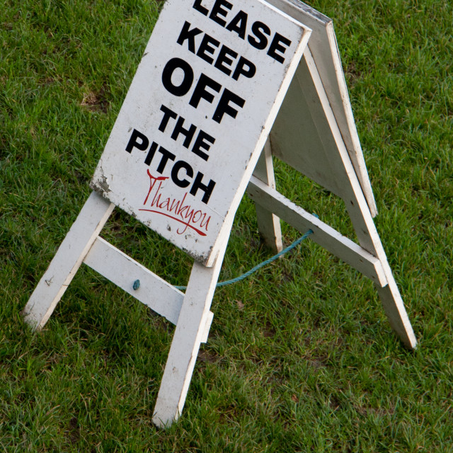 """Please Keep Off The Pitch.'A' board safety sign at Rugby Ground"" stock image"