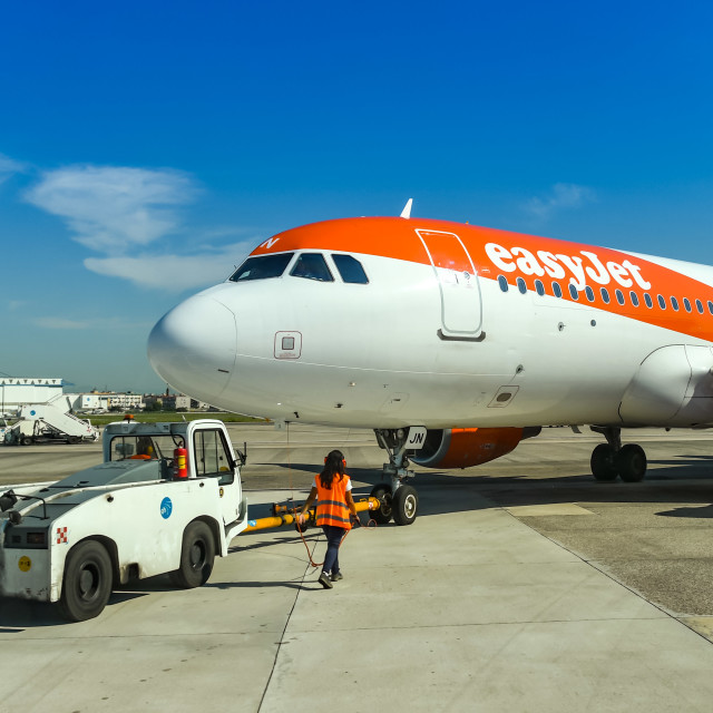 """""""Easyjet Airbus A320 being pushed back by a tug"""" stock image"""