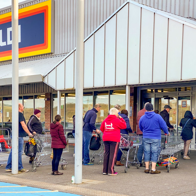 """""""People queuing to shop in an ALDI store during the coronavirus outbreak"""" stock image"""