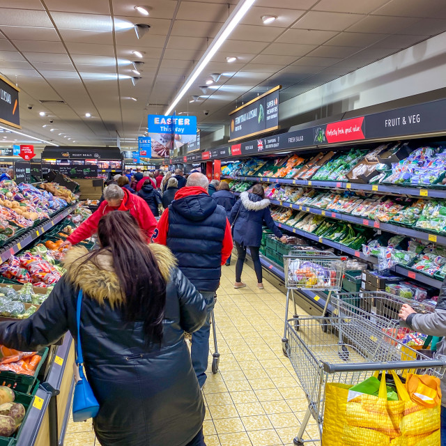 """""""People shopping inside a busy branch of ALDI during the coronavirus outbreak"""" stock image"""